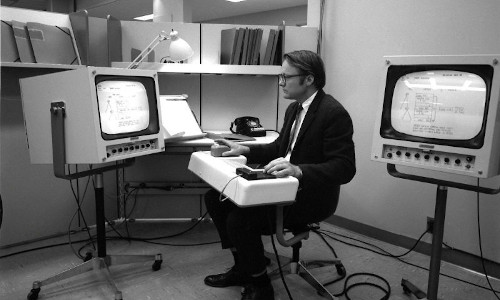 Engineer and researcher William English testing the first computer mouse.